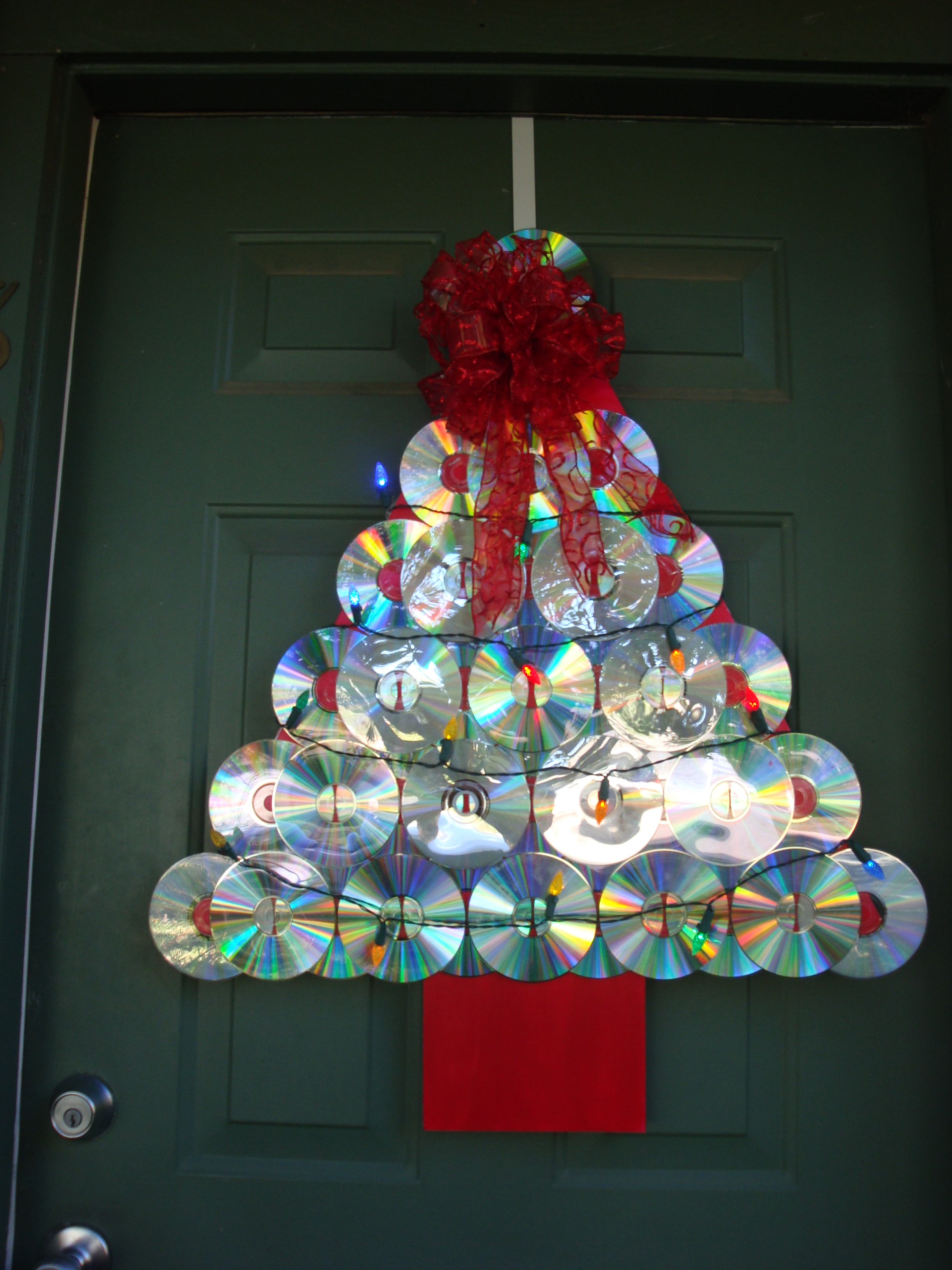 Reuse recycle redecorate christmas tree door decoration for Recycled decoration