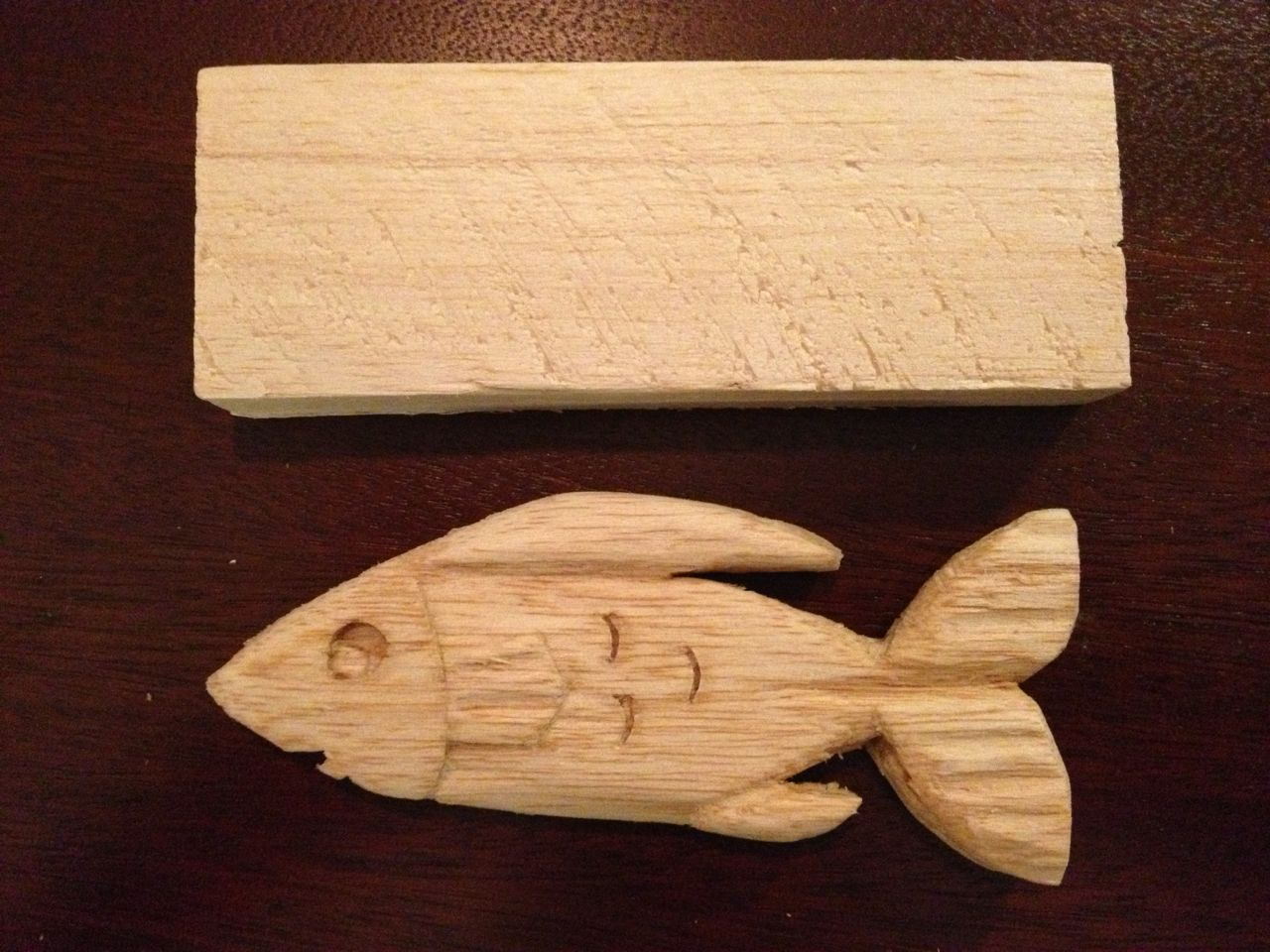 Carving and sanding is finished. Here, the fish is compared to the ...